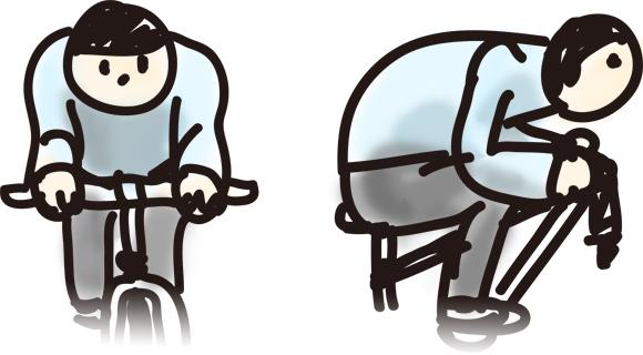 クロスバイクで腕を胸元に折り畳んで前傾姿勢をとる